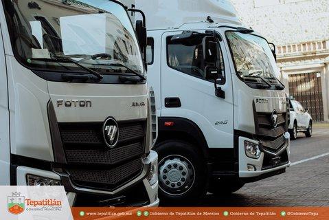 2 camiones FOTON con caja compactadora marca RINO y capacidad de 16 metros cúbicos.